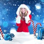 Pretty santa girl smiling at camera — Stock Photo #62504335
