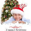 Smiling boy wearing a Christmas hat — Stock Photo #62504787