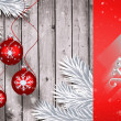 Christmas baubles hanging over wood — Stock Photo #62505235
