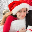 Composite image of little girl getting gift — Stock Photo #62506033