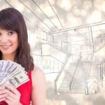 Brunette showing fan of dollars — Stock Photo #62506111
