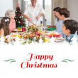Family at dining table for christmas dinner — Stock Photo #62506553
