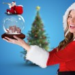 Sexy santa girl holding snow globe — Stock Photo #62506965