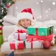 Girl surrounded by christmas gifts — Stock Photo #62507229
