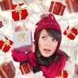 Young woman shaking her gift in order to gues — Stock Photo #62507249