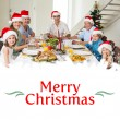 Family at dining table for christmas dinner — Stock Photo #62507425