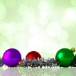 Composite image of christmas baubles and tinsel — Stock Photo #62507457