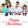 Family opening christmas gifts — Stock Photo #62507469