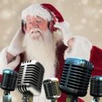 Santa Claus enjoys some music — Stock Photo #62508087