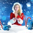Pretty girl holding hands out in santa outfit — Stock Photo #62508215