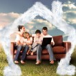 Happy family using the laptop in a field — Stock Photo #62508427