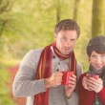 Couple both having warm drinks — Stock Photo #62508549