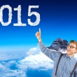 Hipster pointing at 2015 cloud shape — Stock Photo #62508591