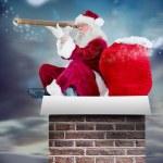 Santa claus looking through telescope — Stock Photo #62508919