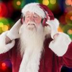 Santa Claus enjoys some music — Stock Photo #62509163