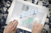 Happy new year against tablet — Stockfoto