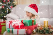 Girl surrounded by christmas gifts — Stockfoto