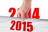 Hand holding sheet with 2015 year — Stock Photo