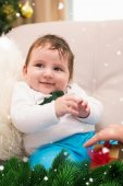Cute baby boy on the couch — Stock Photo
