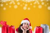 Composite image of festive brunette lying with shopping bags — Stock Photo