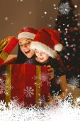 Festive mother and daughter opening a christmas — Stok fotoğraf
