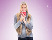 Woman in winter clothes holding mug — Foto Stock