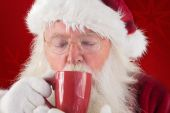 Santa drinks from red cup — Stock Photo