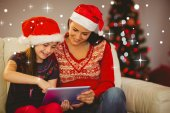 Festive mother and daughter using tablet — Stock Photo