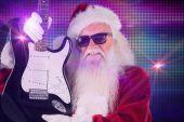 Father Christmas shows guitar — Stock Photo