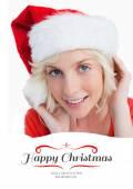 Blonde woman putting on Santa hat — Stock Photo