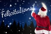 Santa claus points at something — Foto de Stock