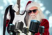 Father Christmas shows guitar — Stock Photo