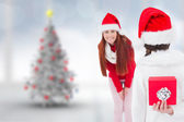 Mother and daughter with gift — Stock Photo