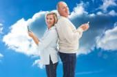Happy mature couple using their smartphones — Stock Photo