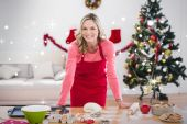 Festive blonde making christmas cookies — Stock Photo