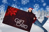 Woman holding a gift card — Stock Photo