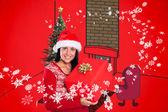 Joven morena con regalo de navidad — Foto de Stock