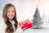 Composite image of girl holding gift — Foto de Stock