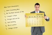 Businessman pointing at calendar he is holdin — Stockfoto