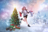 Blonde jumping with shopping bags — Stock Photo