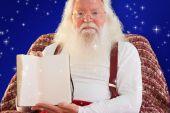 Santa Claus showing book — Stock Photo