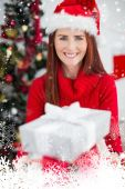Festive redhead holding christmas gifts — 图库照片