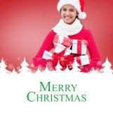 Imagen compuesta de regalos celebración festiva morena — Foto de Stock