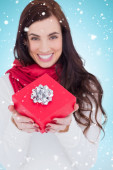 Brunette holding red gift with a bow — Stock Photo