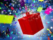 Santa flying behind big gift — Stock Photo