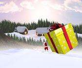 Santa delivering large gift — Foto de Stock