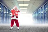 Santa carrying gifts — Stock Photo