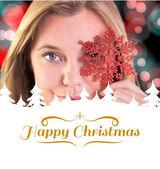 Festive blonde holding a snowflake — Stock Photo