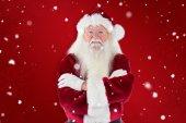 Santa smiles with folded arms — Stock Photo