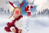 Cute little girl wearing red nose and tinsel — Foto Stock
